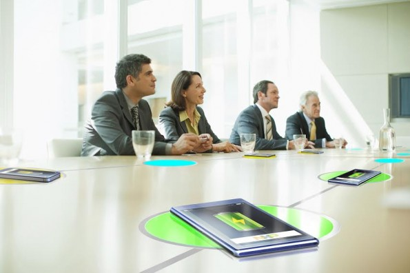 Business people sitting in conference room talking