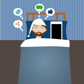 Hipster man in the bed time with smart phone