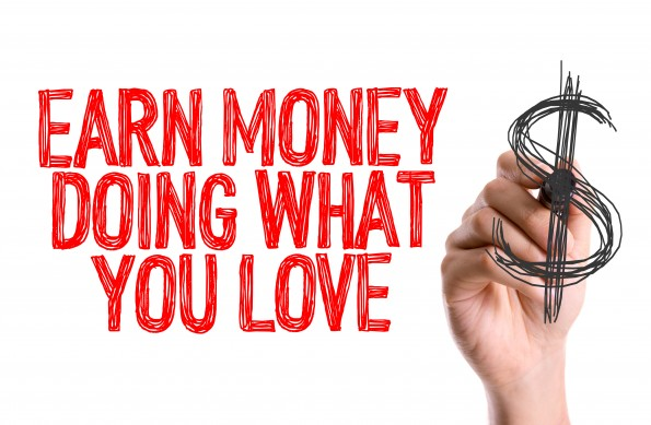 Hand with marker writing: Earn Money Doing What You Love