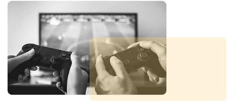 Afbeelding van twee personen die aan het gamen zijn.
