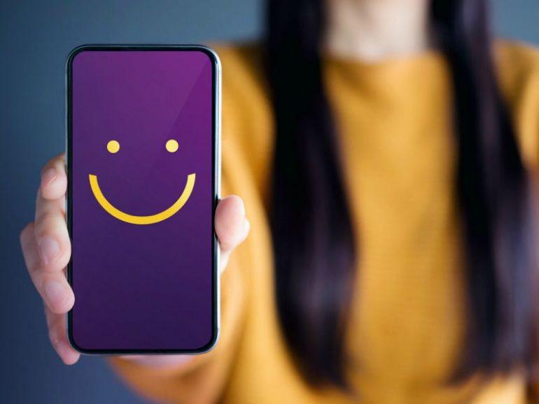 Blije emoji als illustratie van een positieve customer experience (CX)