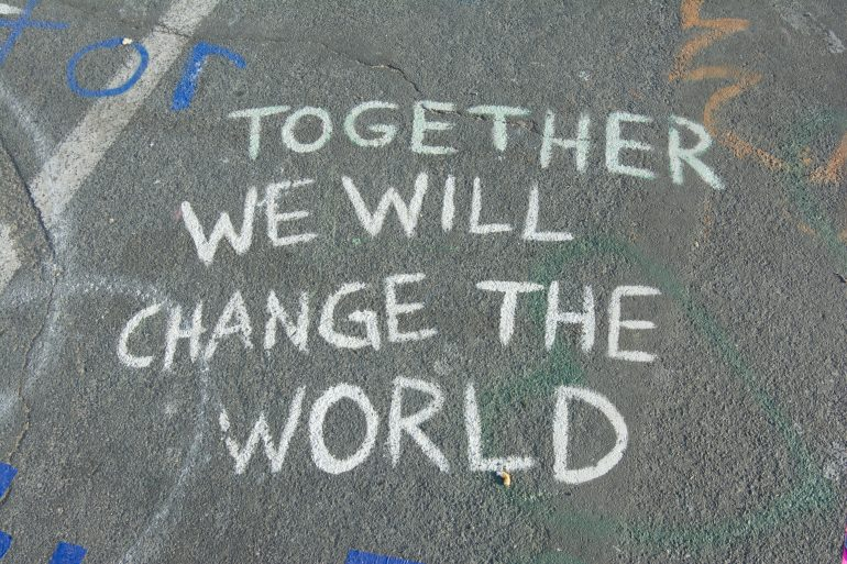 Tekst: together we will change the world